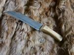 Couteau tranchant rapporté -